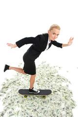 Portrait of woman standing on skateboard inside.