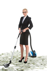 Attractive female businesswoman with vacuum cleaner.
