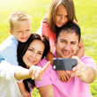 family taking selfie with smartphone