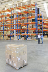 Pallet of wrapped cardboard boxes in distribution warehouse