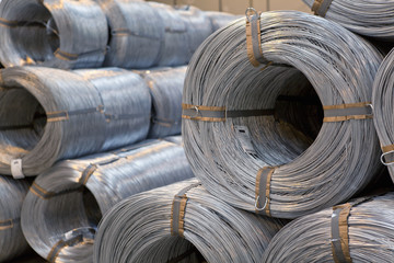 Coiled steel cable rolls stacked in warehouse