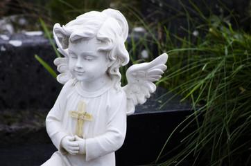 white angel praying