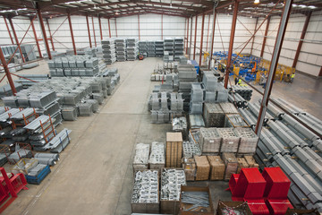 Steel tubing and finished safety barriers in warehouse