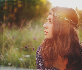Beautiful hippie girl in the park.