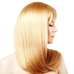 Hair. Beauty young woman with luxurious long blond hair. Girl wi