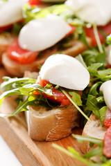 Tomato, mozzarella and arugula sandwich