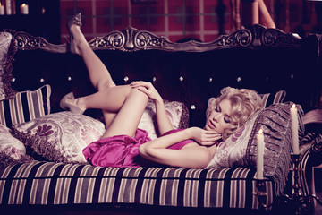 Luxury woman. Young fashionable slim pretty woman in the bedroom