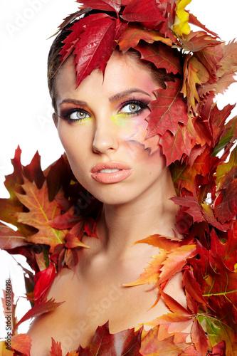 Leinwandbild Motiv Autumn woman dressed in red leaves