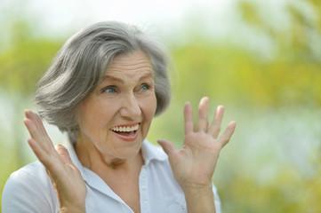 Surprised elder woman