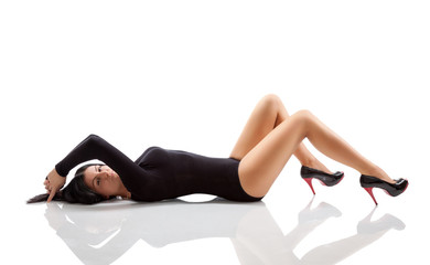 Woman with a stunning body lying on floor