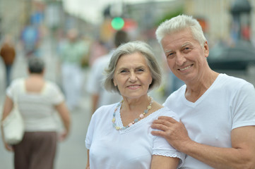 Mature couple walking in town