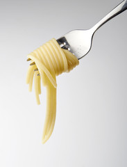 Close up of a silver fork with spaghetti