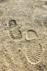 Schuhabdrücke im Sand