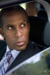 Businessman in car, close-up