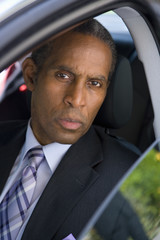 Businessman in car, portrait, elevated view