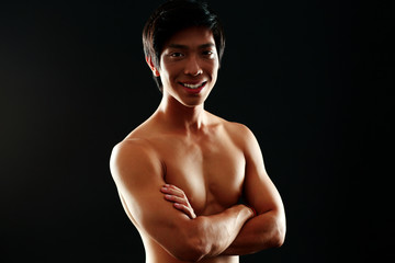 Handsome asian man isolated on black background