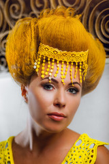 Model in a yellow cloth. The portrait.