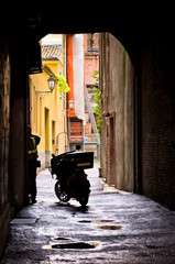 Mail delivery at typical backstreet at downtown of Ferrara