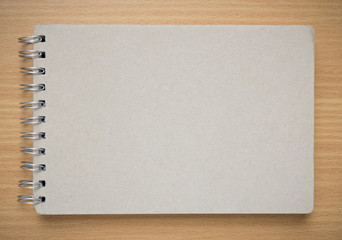 recycle notebook cover on wood background