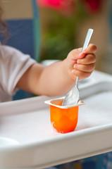 Baby eating yogurt