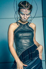 Fashion model with futuristic hairstyle and make-up.