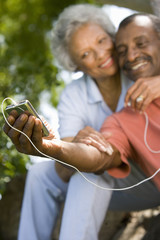 Senior couple with MP3 player, smiling