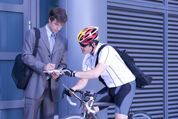 Businessman signing for bicycle courier