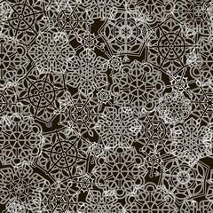 White snowflakes on a black background. Seamless pattern