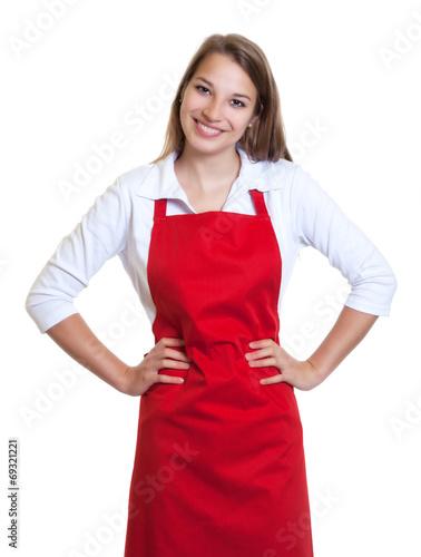 Leinwanddruck Bild Lachende Frau mit roter Schürze