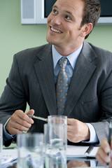 Businessman in meeting, smiling