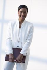 Smiling businesswoman holding binder