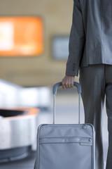 Businesswoman pulling luggage