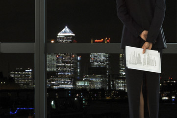 Businesswoman looking at city view