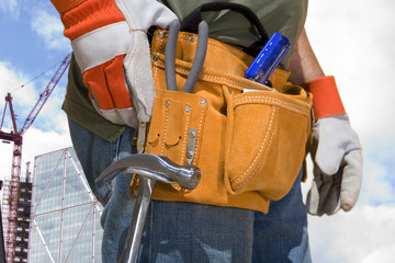 Close up of construction worker's tool belt