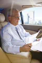 Businessman riding in town car
