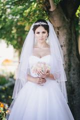 Beautiful bride posing in a park