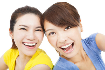 Closeup portrait of happy young girls over white background