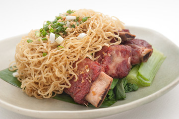 Pork ribs with vegetables and noodles