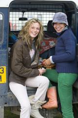 Portrait of young women in front of van