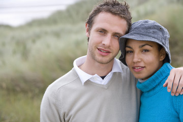 Portrait of young couple outdoors