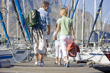 Family walking in boat marina