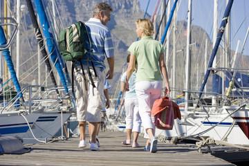 Family walking in boat marina