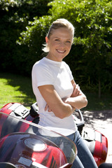 Woman posing with motorcycle