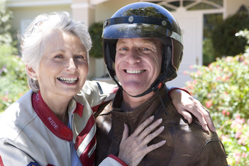 Mature couple in motorcycle gear