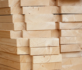 Stack of wooden planks inside workshop