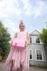 Girl in pink holding birthday gift