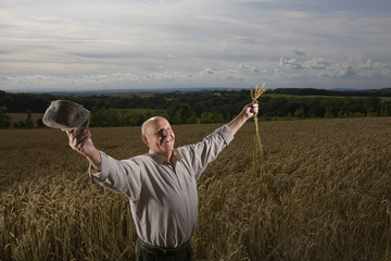 Farmer standing in wheat field