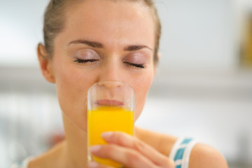 Young woman drinking fresh orange juice