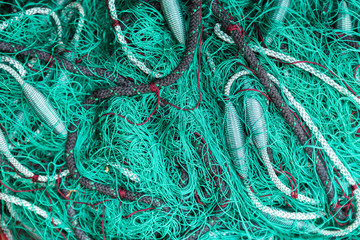 Green fishing net on the heap, closeup view