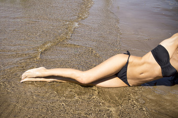 Young woman sunbathing in bikini